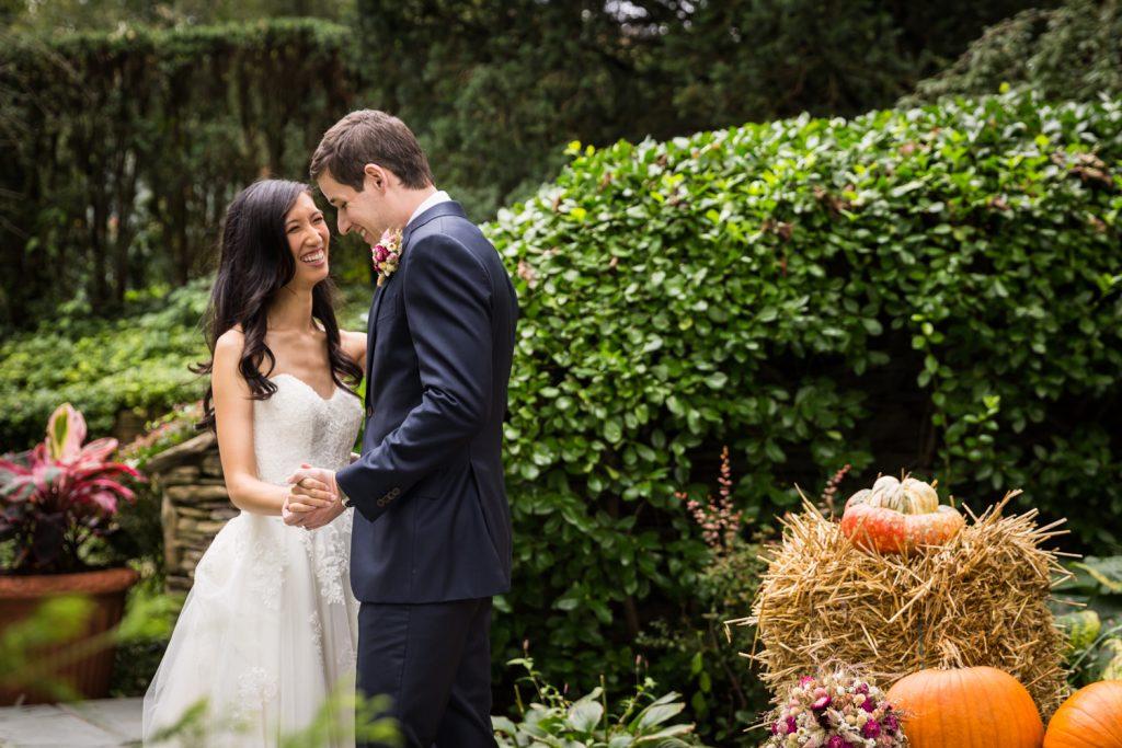 Bride and groom dancing in garden at a Westbury Manor