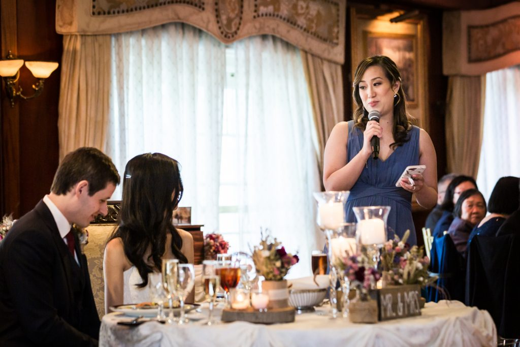 Maid of honor making speech to bride and groom at a Westbury Manor wedding
