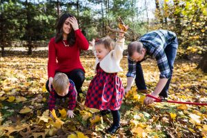 Family in leaves for article on how to get your kids to look into the camera