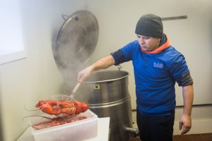 Man with steaming lobster for an article on website photography tips