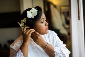 Bride with flowers in her hair for an article on destination wedding photography tips
