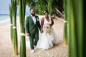 Bride and groom walking down aisle for an article on destination wedding photography tips