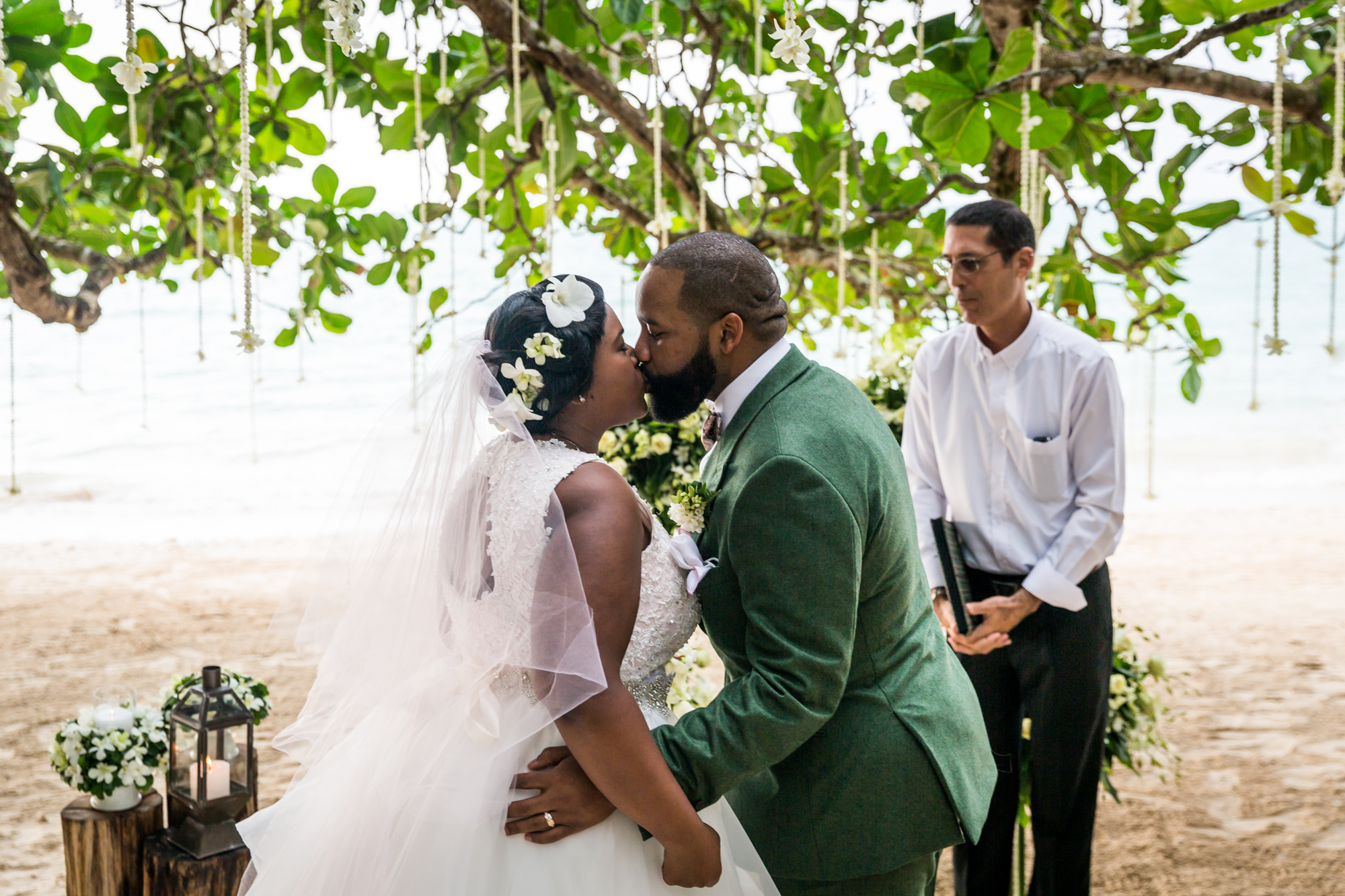 Bride and groom kissing for an article on destination wedding photography tips