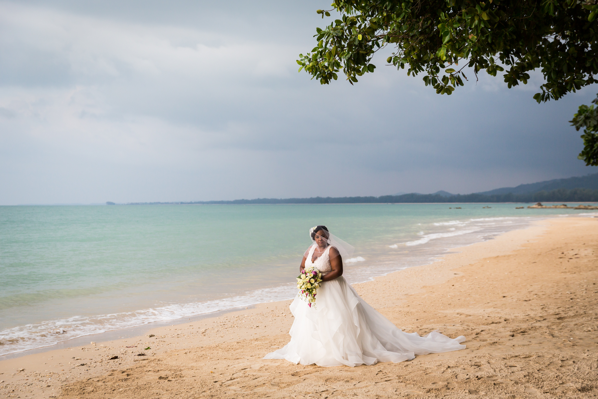 Bride on beach for an article on destination wedding planning tips