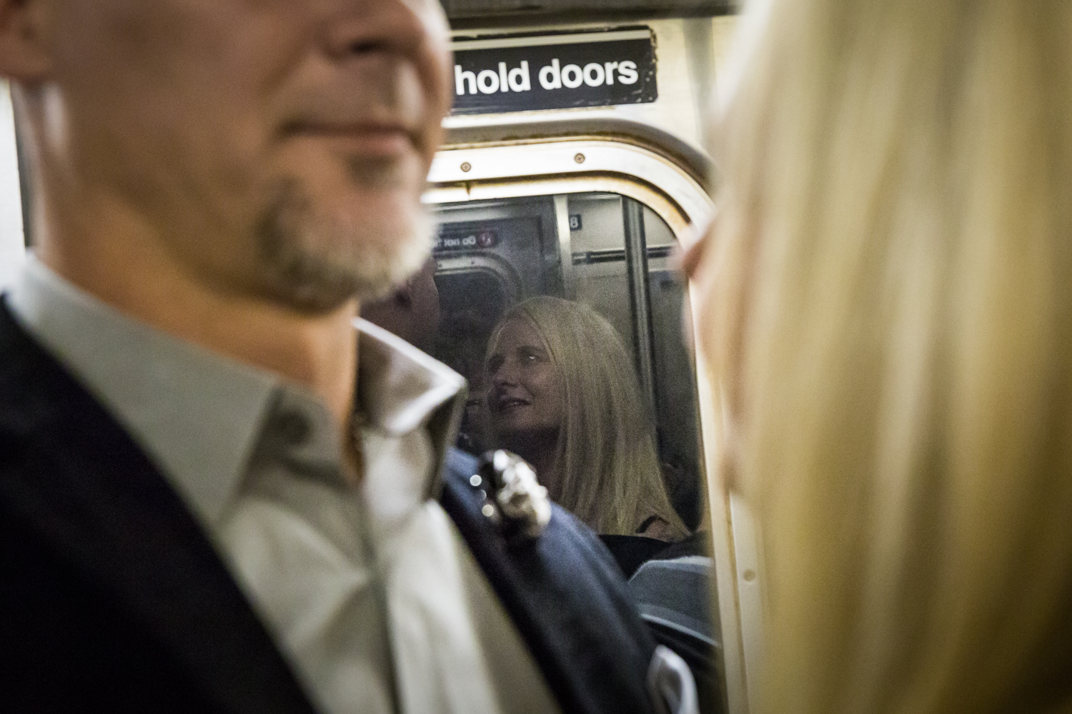 Reflection of woman in window of subway car
