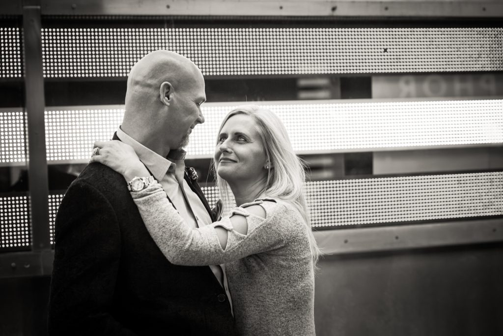 Black and white photo of couple hugging in Times Square