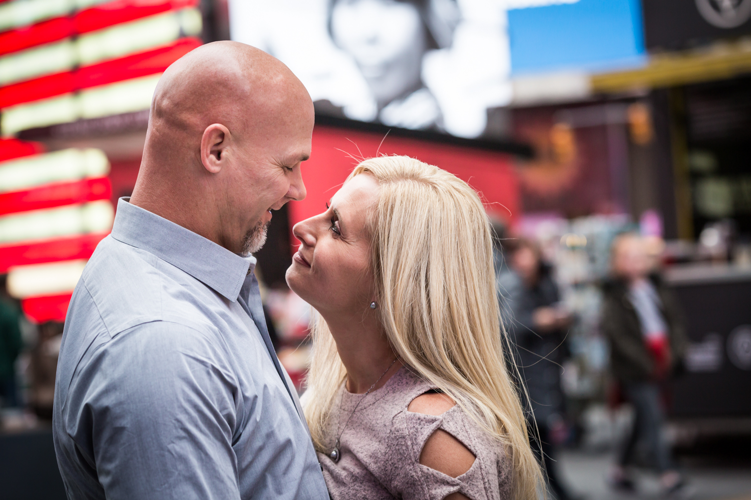 Couple hugging in Times Square for an article on how to propose on top of the Empire State Building