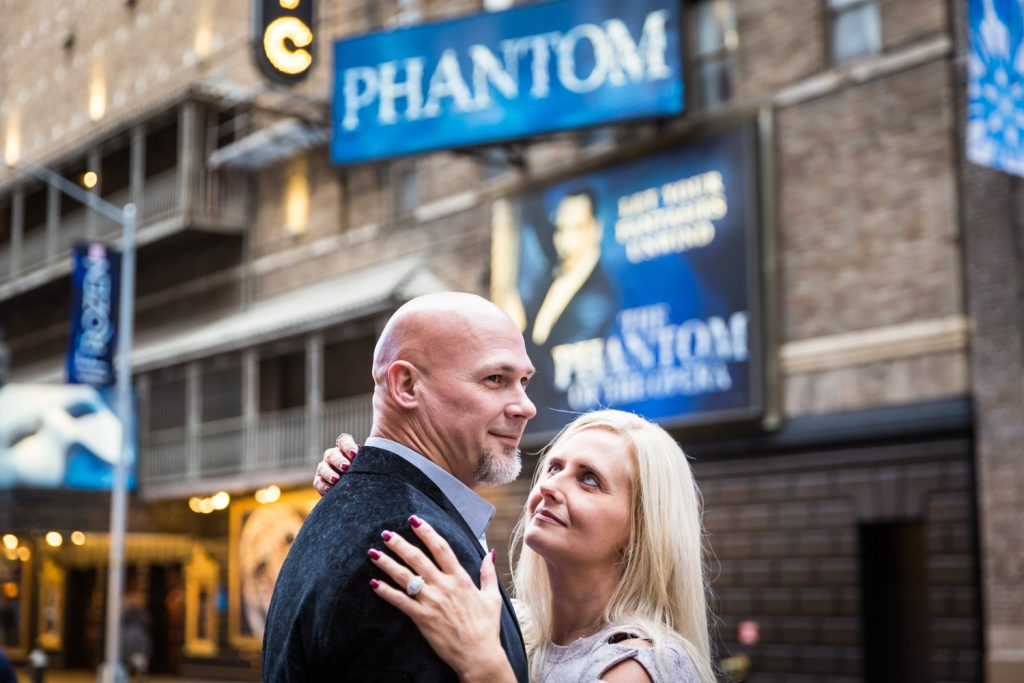 Couple in front of Phantom theater in Times Square