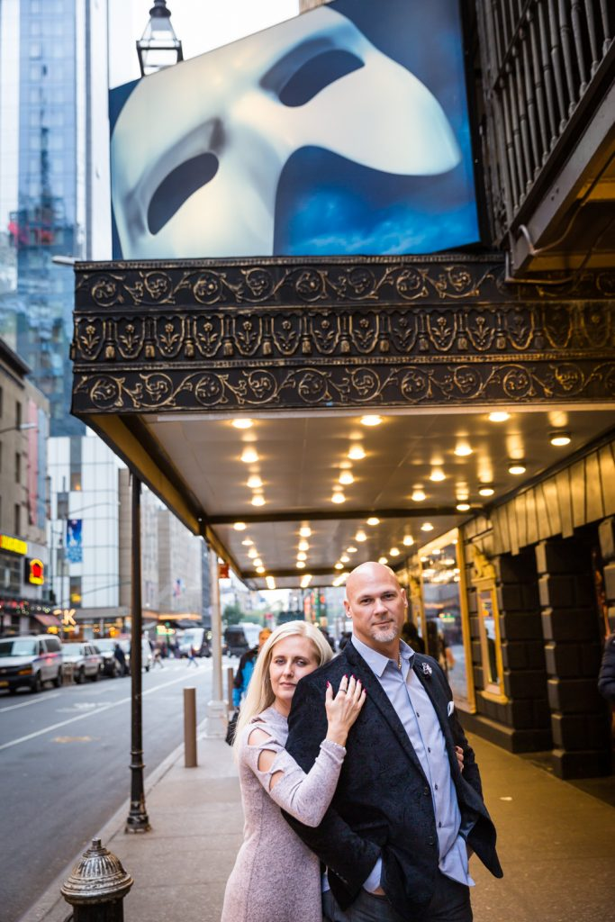 Couple in front of Broadway theater for an article on how to propose on top of the Empire State Building