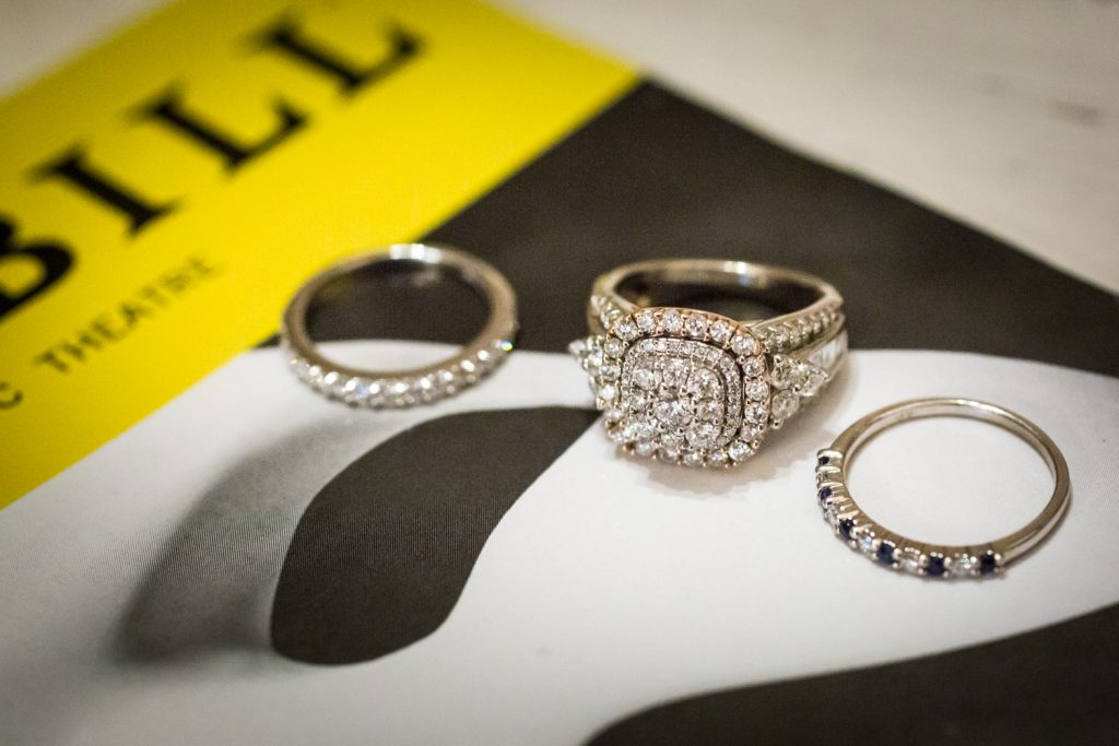 Close up of engagement rings on a Phantom playbill