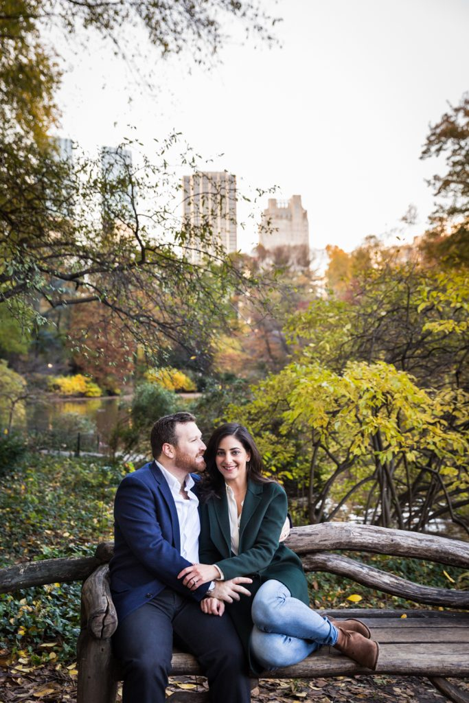 Couple sitting on wooden bench in Central Park