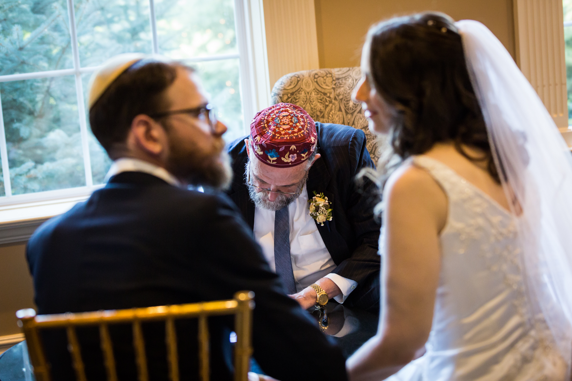 Bride and groom at ketubah signing for an article on band vs DJ