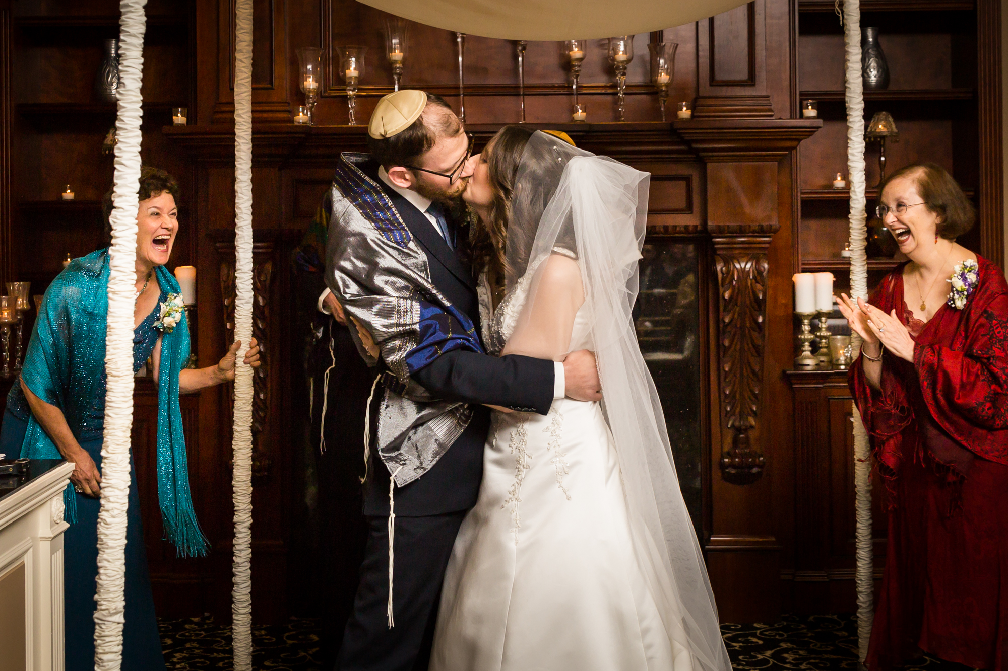 Bride and groom kissing for an article on band vs DJ