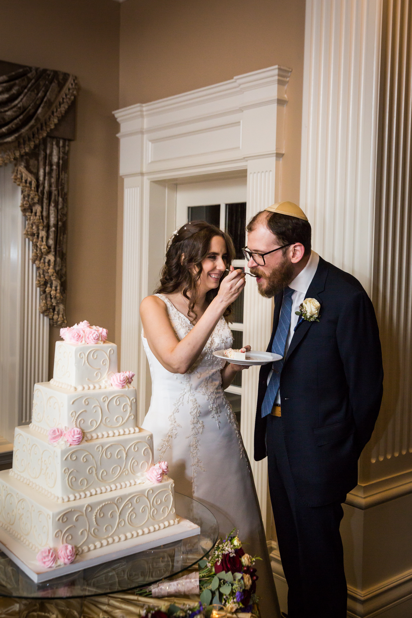 Bride and groom during cake cutting for an article on band vs DJ