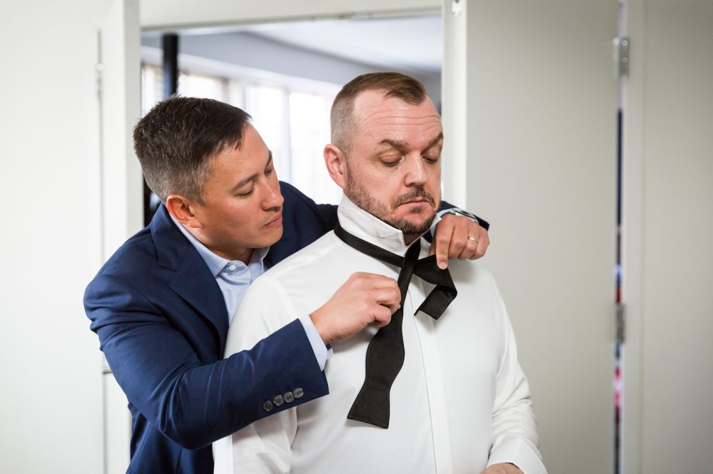 Grooms getting ready at a same sex wedding celebration in Washington DC