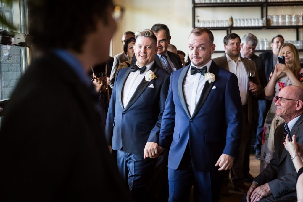 Grooms walking down the aisle at a same sex wedding celebration in Washington DC