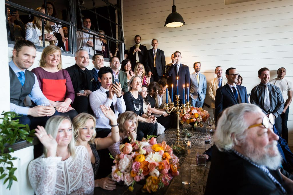 Guests at a ceremony at a same sex wedding celebration in Washington DC