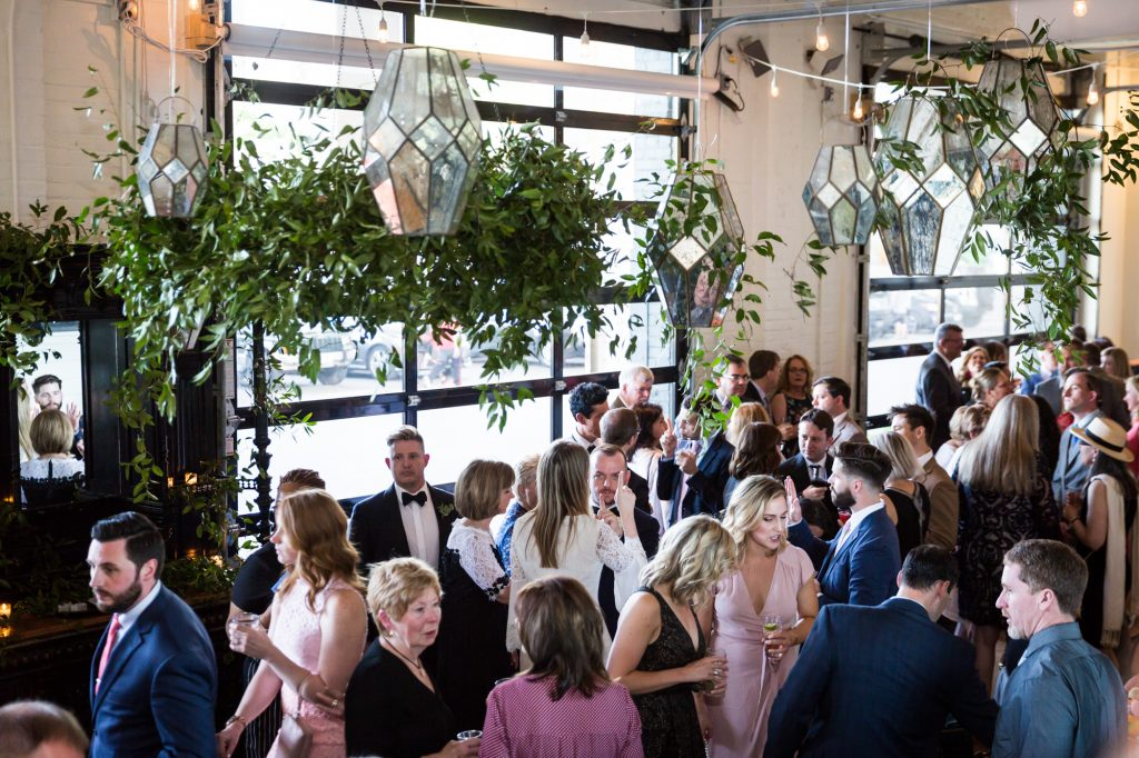 Guests mingling at a same sex wedding celebration in Washington DC