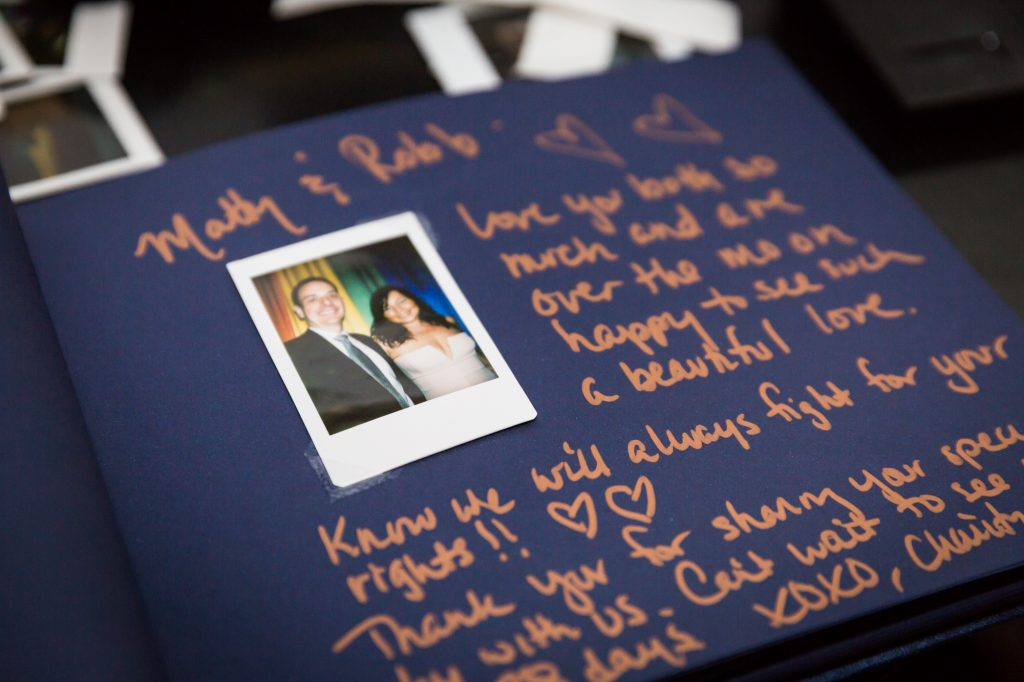 Polaroid guest book at a same sex wedding celebration in Washington DC