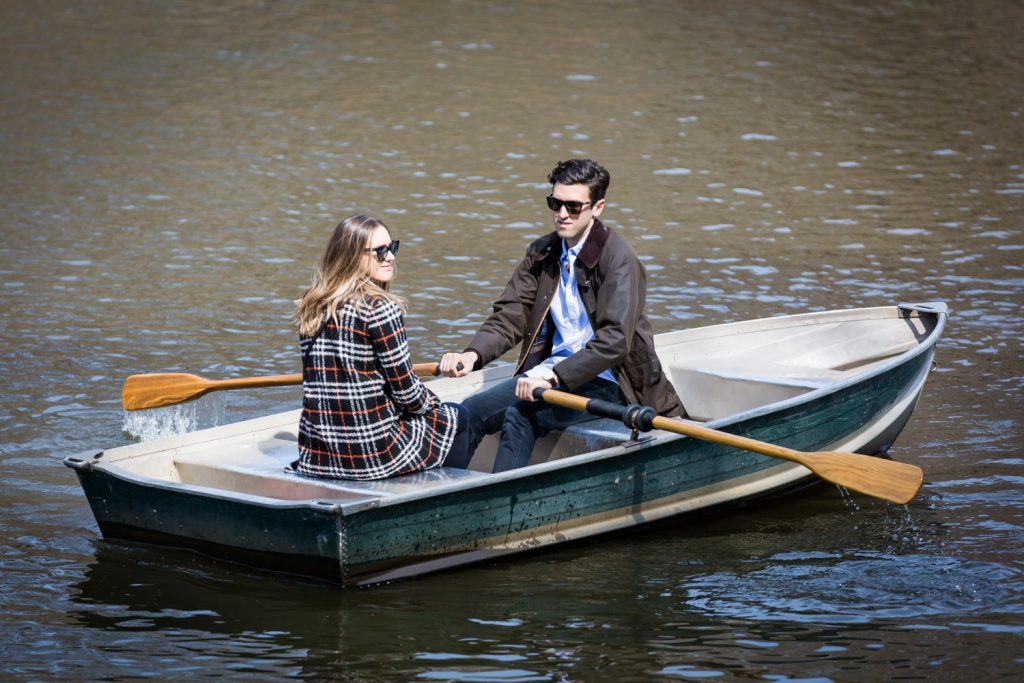 Man and woman wearing sunglasses and rowing a boat for article on Central Park Lake proposal tips