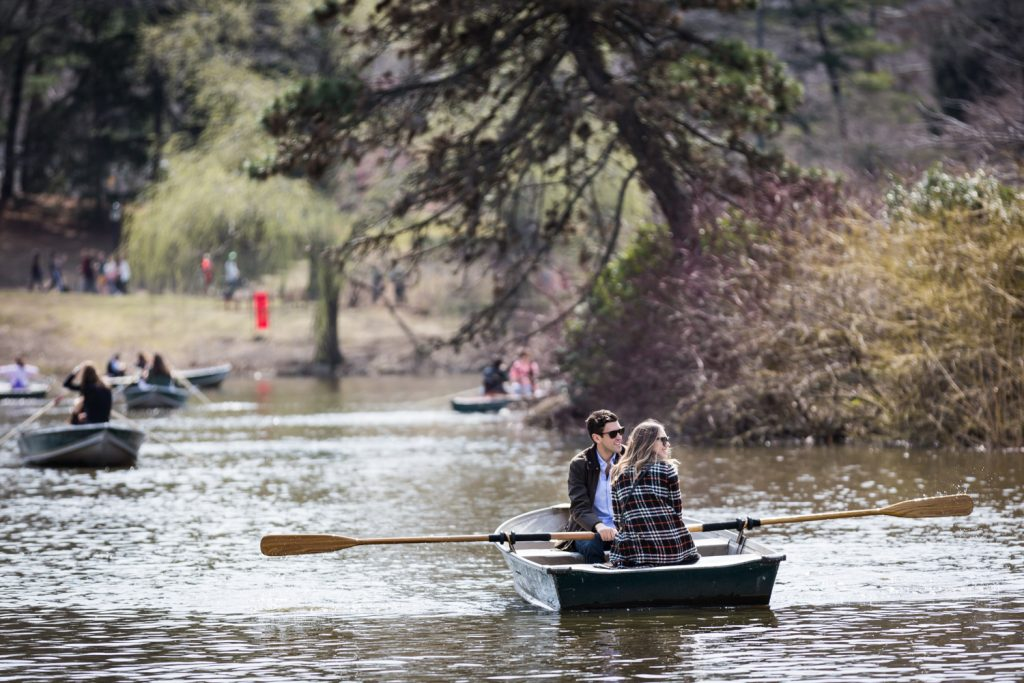 People rowing boats in Central Park Lake for an article on Central Park Lake proposal tips