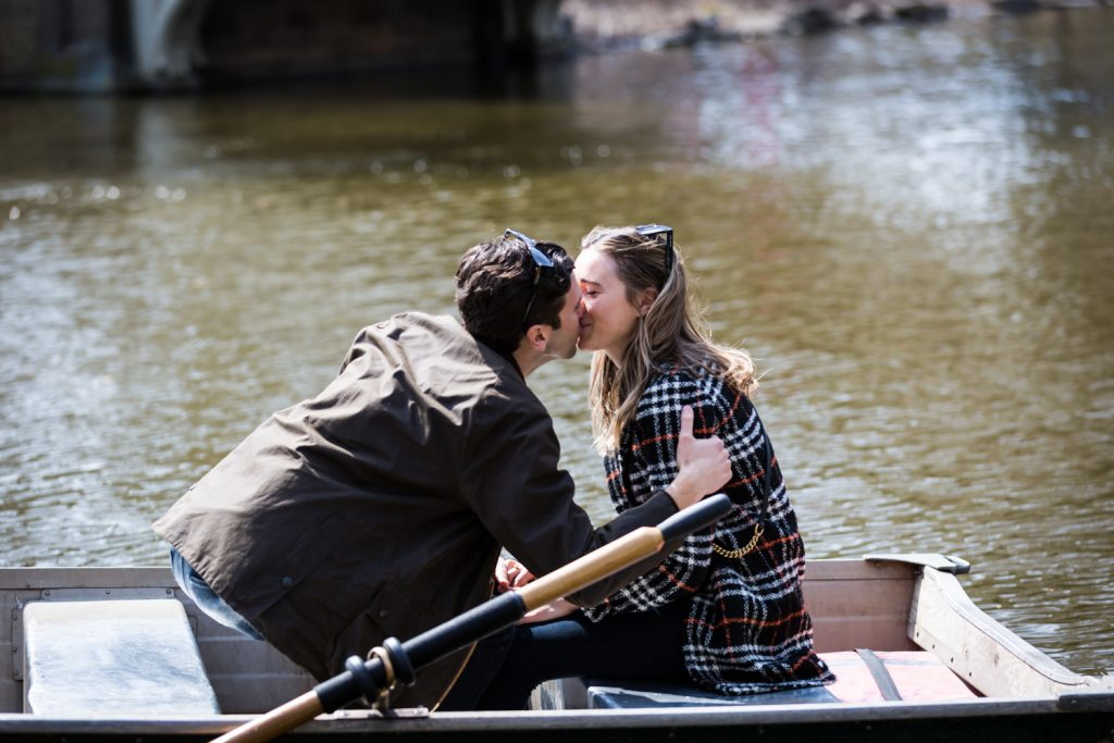 Man and woman kissing in boat on Central Park Lake