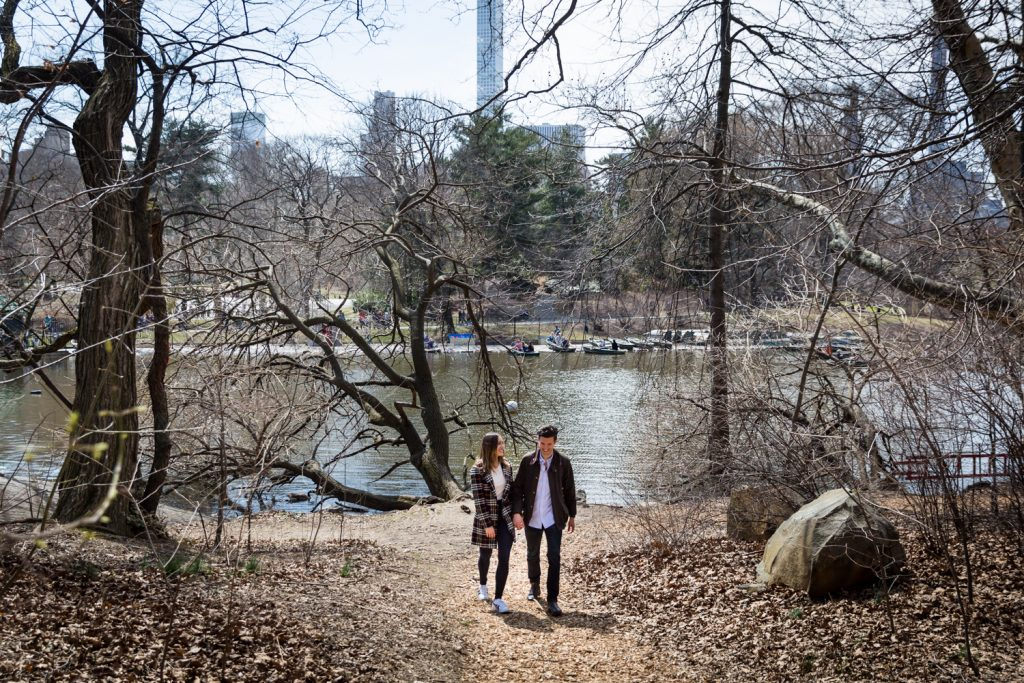 Man and woman walking in the Ramble for article on Central Park Lake proposal tips