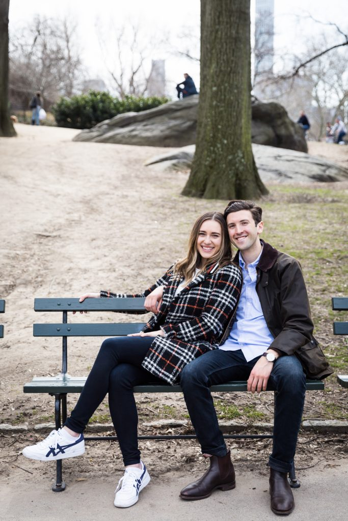 Portrait of man and woman on bench in Central Park for article on Central Park Lake proposal tips