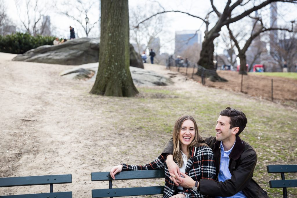 Couple sitting on bench in Central Park