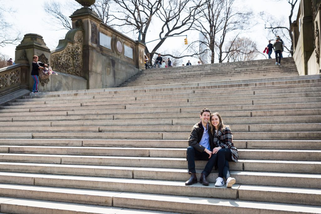 Portrait of couple sitting on steps of Bethesda Fountain