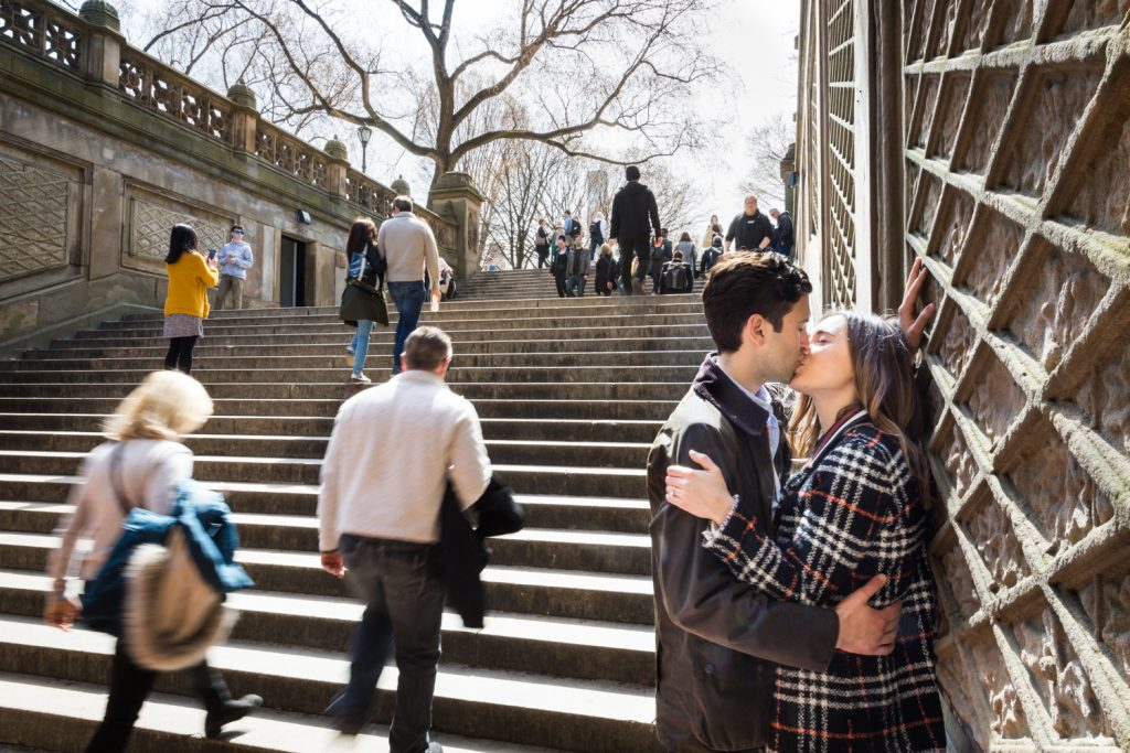 Couple kissing by Bethesda Fountain steps