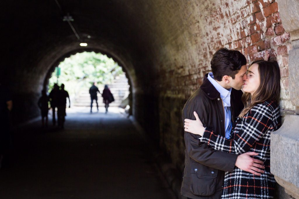 Couple kissing in Trefoil Arch