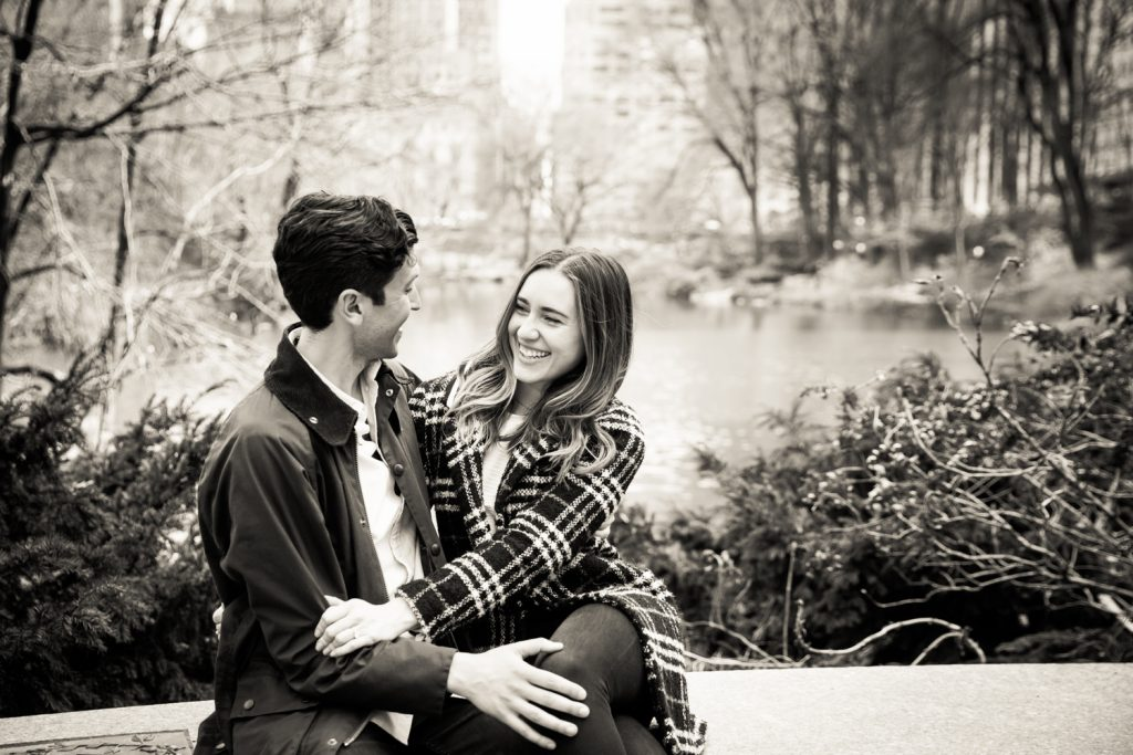 Black and white photo of couple with Central Park Lake in background