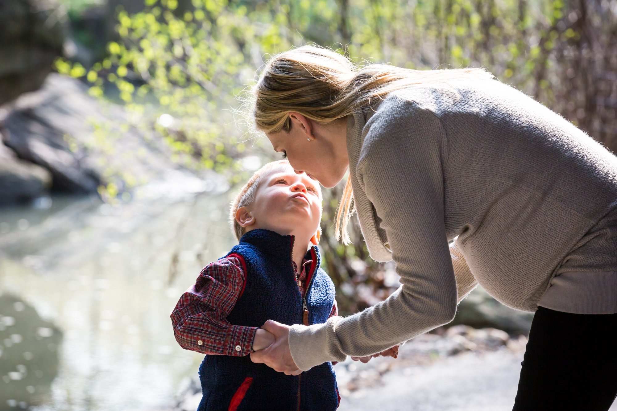 Mother kissing son for an article on the best family portrait poses