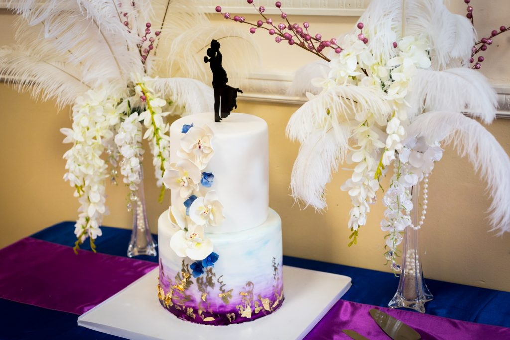 Elaborate wedding cake with orchids and feathers