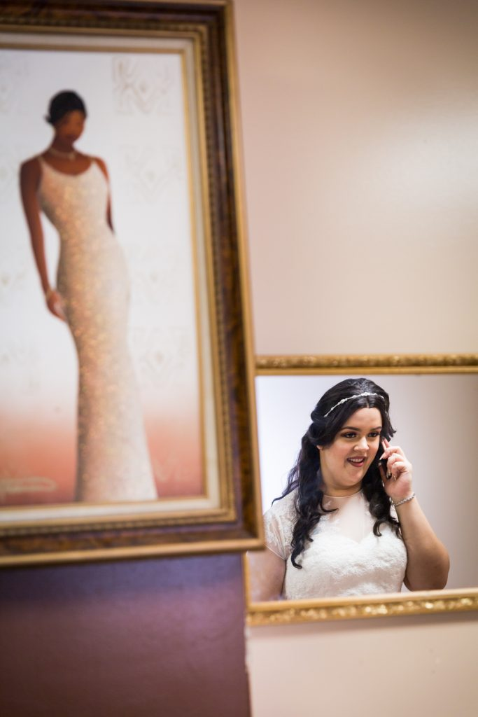 Reflection of bride talking into cell phone for an article on wedding photography timeline tips