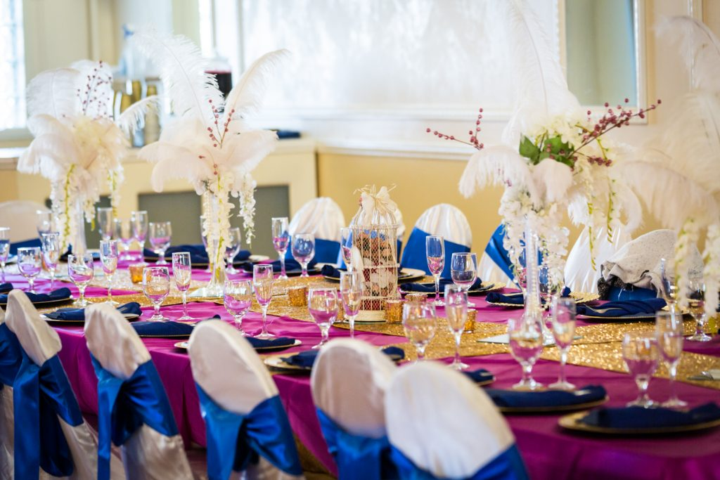 Table setting with feather centerpieces for an article on wedding photography timeline tips