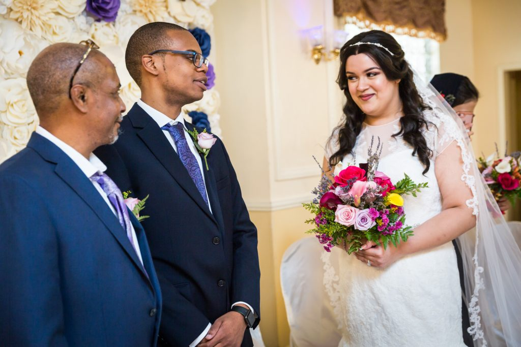 Bride and groom looking at each other during ceremony for an article on wedding photography timeline tips