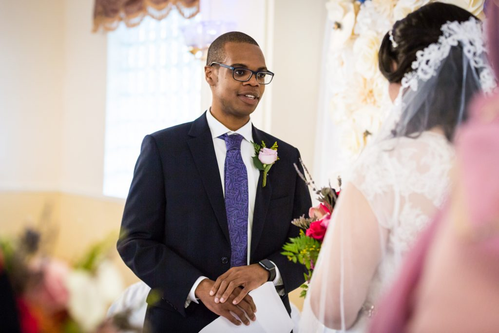 Groom saying vows to bride for an article on wedding photography timeline tips