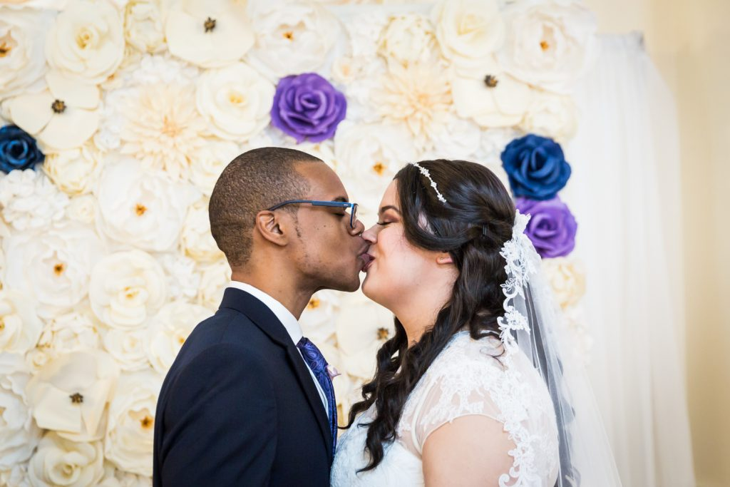 Bride and groom kissing for an article on wedding photography timeline tips