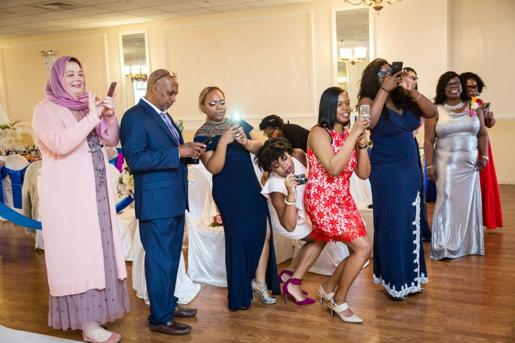 Guests taking photos during wedding ceremony for an article on wedding photography timeline tips