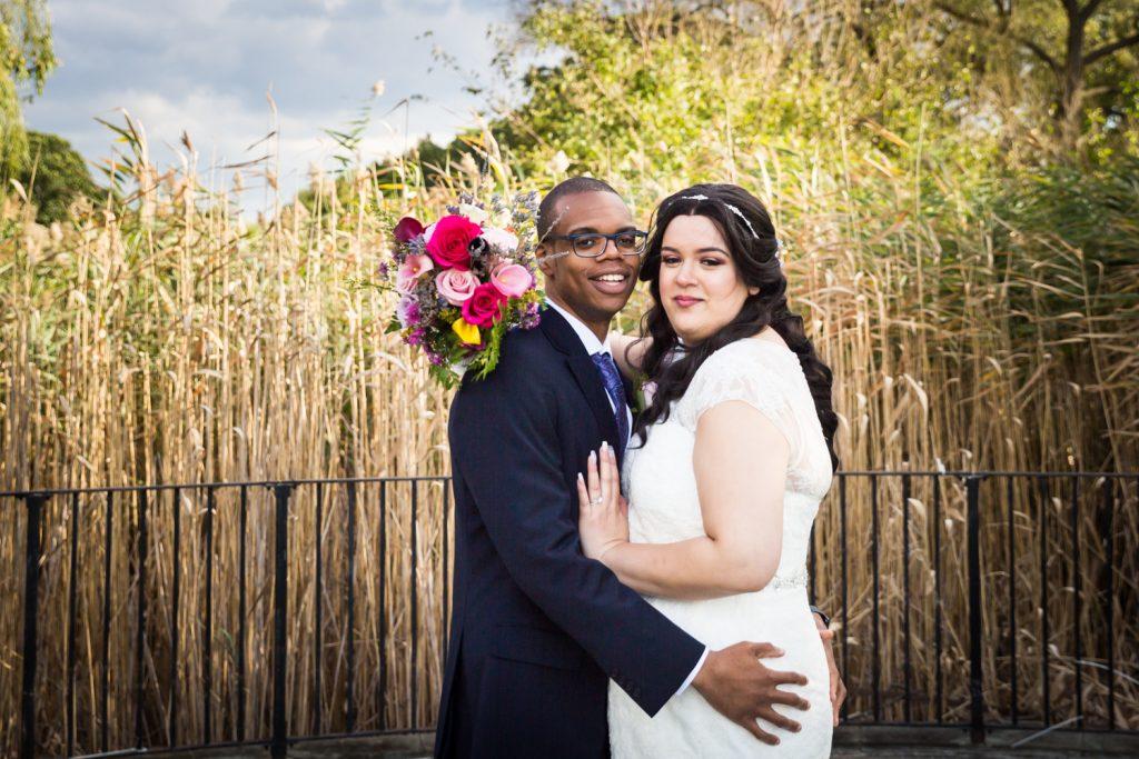 Portrait of bride and groom in park in Jamaica, Queens