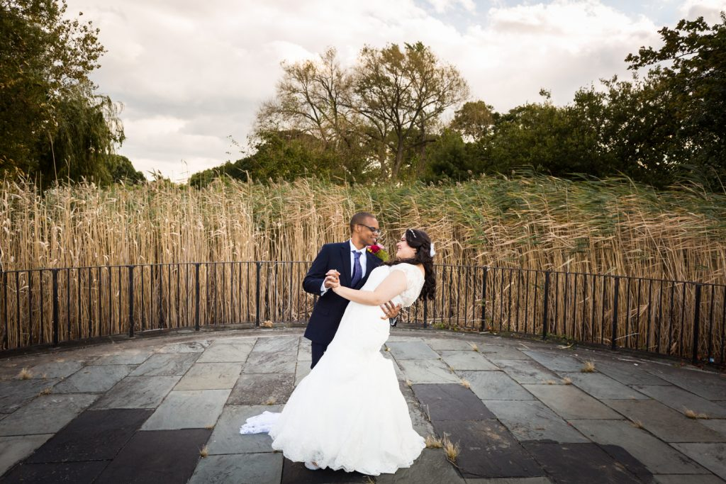 Bride and groom dancing on patio in park for an article on wedding photography timeline tips