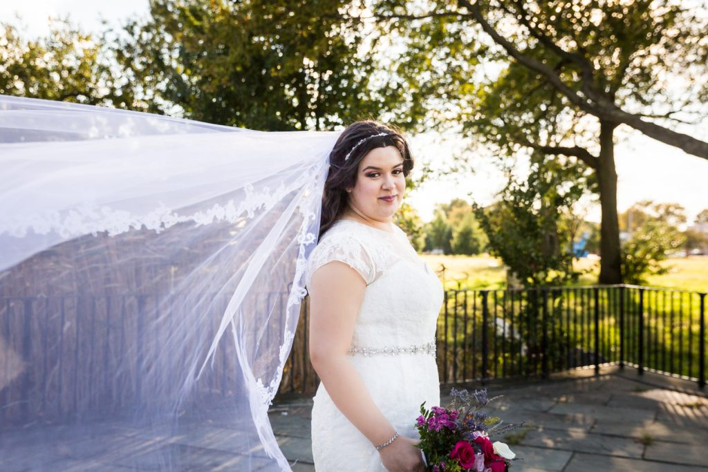 Portrait of bride with blowing veil