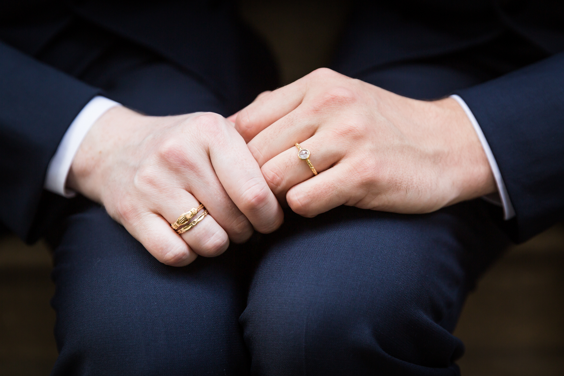 Two grooms holding hands The Dakota apartment building