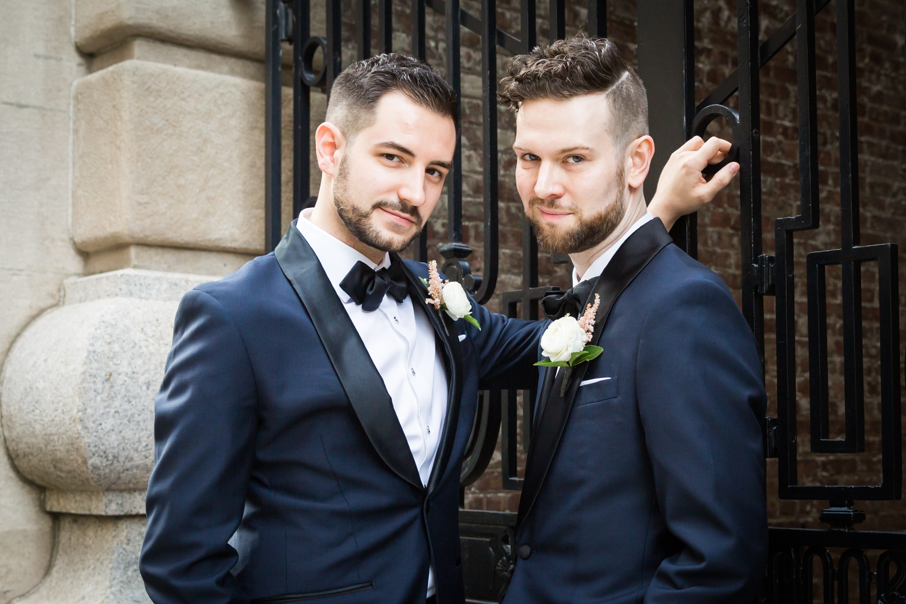 Wedding portraits of two grooms The Dakota apartment building