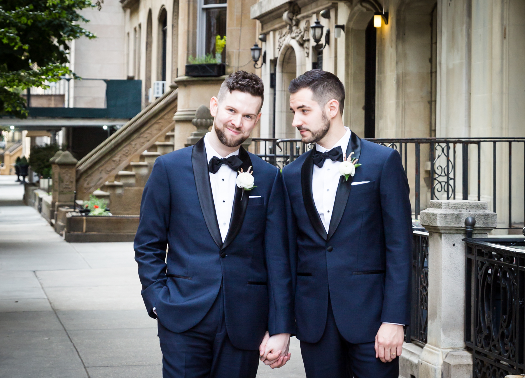 Two grooms on NYC sidewalk for an article entitled, 'Do you need a permit to get married in Central Park?'