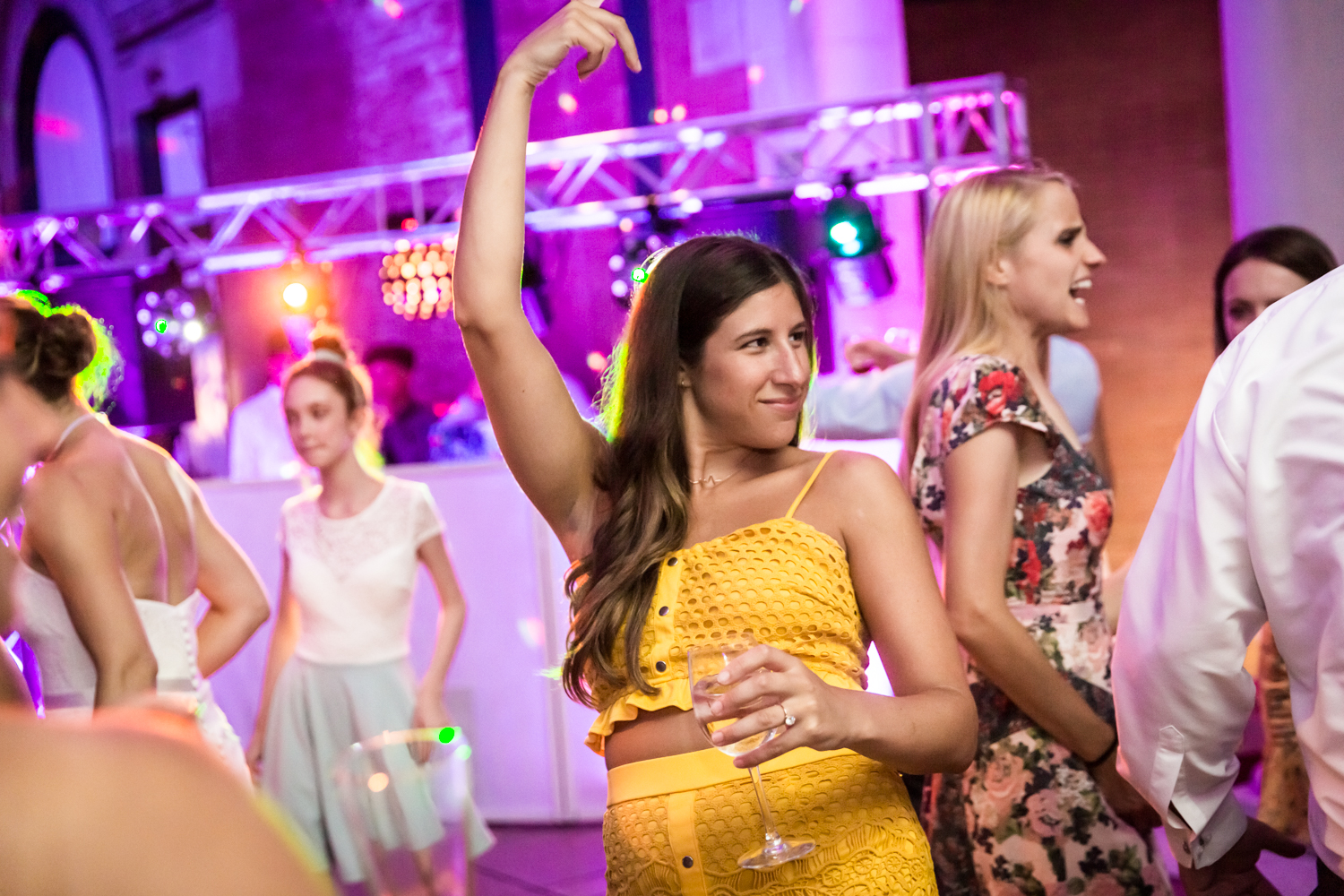Guest in yellow dress dancing for an article on Bronx Zoo wedding venue updates