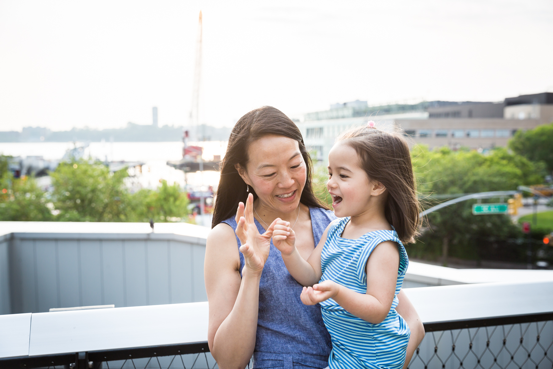 Mother playing with daughter for an article on High Line family portrait tips