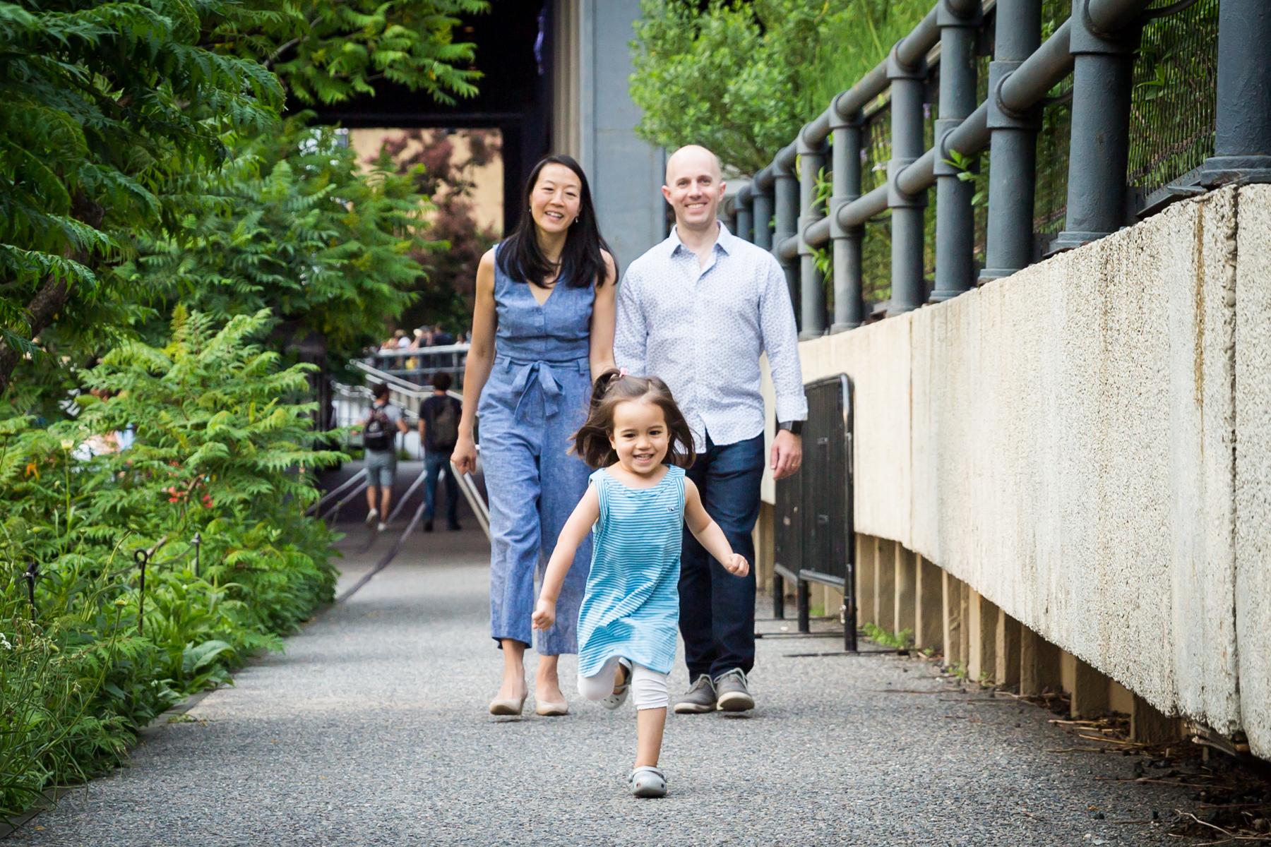 Little girl running for an article on High Line family portrait tips